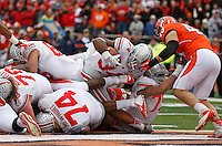 Ohio State Buckeyes running back Carlos Hyde (34) bulls his way into the end zone for a touchdown after the previous attempt when was ruled down after initially being signaled a TD  at Memorial Stadium in Champaign, Illinois on November 16, 2013.  (Chris Russell/Dispatch Photo)