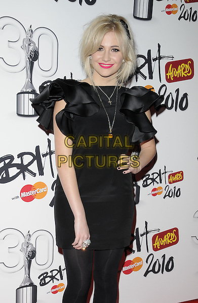 PIXIE LOTT (Victoria Louise Lott) .Brit Awards Nominations at Indigo O2, London, England, UK, .January 18th 2010. .brits half 3/4 length black dress tights ruffle ruffles sleeve hairband headband head hair band hand on hip necklace .CAP/CAN.©Can Nguyen/Capital Pictures