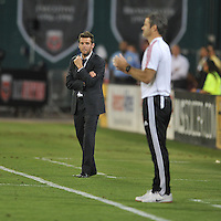 D.C. United head coach Ben Olsen overlooks at Toronto FC head coach Ryan Nelsen at the end of the game. Toronto FC defeated D.C. United 2-1, at RFK Stadium, Saturday June 15 , 2013.