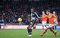 Marcus Bean of Wycombe Wanderers passes under pressure from Alex Lawless of Luton Town during the Sky Bet League 2 match between Wycombe Wanderers and Luton Town at Adams Park, High Wycombe, England on 6 February 2016. Photo by Andy Rowland.