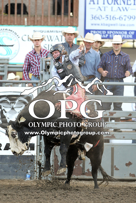 21 Aug 2013:  Cooper Davis riding the bull Black Diamond was not able to score in the first round of competition of the Extreme Bulls Wednesday at the Kitsap County Fair and Stampede Rodeo in Bremerton, Washington.