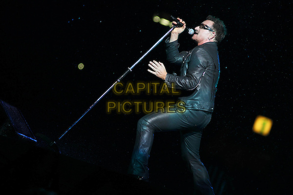 U2 - Bono.Concert in Moscow, Russia..August 25th, 2010.on stage in live gig performance performing music full length black leather jacket side profile singing sunglasses shades .CAP/PER/SB.©SB/PersonaStars/CapitalPictures
