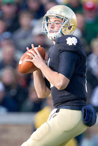 Notre Dame quarterback Tommy Rees (#11) sets to pass the ball during second quarter of NCAA football game between Notre Dame and Navy.  The Notre Dame Fighting Irish defeated the Navy Midshipmen 56-14 in game at Notre Dame Stadium in South Bend, Indiana.