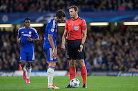 Cesc Fabregas of Chelsea looks downbeat as he speaks to Referee Felix Zwayer (GER) during the UEFA Champions League match between Chelsea and Maccabi Tel Aviv at Stamford Bridge, London, England on 16 September 2015. Photo by Andy Rowland.