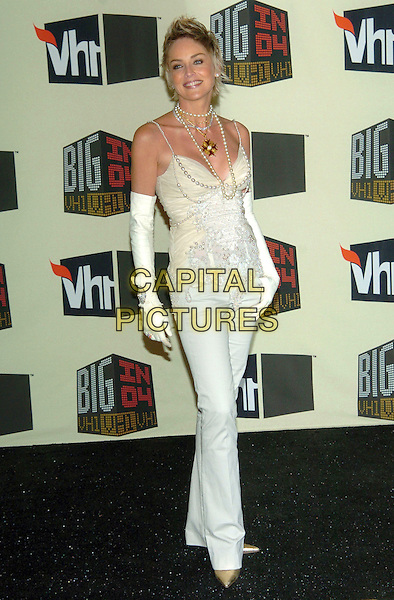 SHARON STONE.VH1 Big in '04 held at the Shrine Auditorium, Los Angeles, California, 01 December 2004..full length long white elbow length arm gloves beads pearls necklaces cream beige camisole top.**UK SALES ONLY**.Ref: ADM.www.capitalpictures.com.sales@capitalpictures.com.©V.Summers/AdMedia/Capital Pictures .