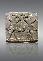 Hittite relief sculpted orthostat stone panel of Herald's Wall Basalt, Karkamıs, (Kargamıs), Carchemish (Karkemish), 900-700 B.C. Bird-headed, winged figures of human body. Anatolian Civilisations Museum, Ankara, Turkey.<br /> <br /> These figures are called as &quot;Winged Griffin Demons&quot;. Embossing is constructed symmetrically. Their hands are on their heads. It is assumed that they carry the heavens.