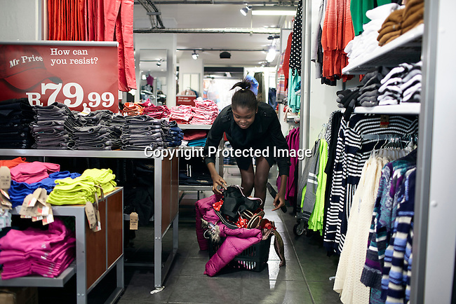 CAPE TOWN, SOUTH AFRICA AUGUST 13: Favour Lucky, a 15-year old Nigerian model, shops for clothes in a shopping mall on August 13 2013 in Cape Town, South Africa. She won Nigeria's next supermodel and has worked at fashion weeks in Johannesburg, Cape Town, New York and others. (Photo by: Per-Anders Pettersson)
