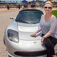 Eva Sugden Gomez with her electric Tesla Roadster at Bayfront, Naples, Florida, USA, July 19, 2012. Photo by Debi Pittman Wilkey, CoastalLife.com.