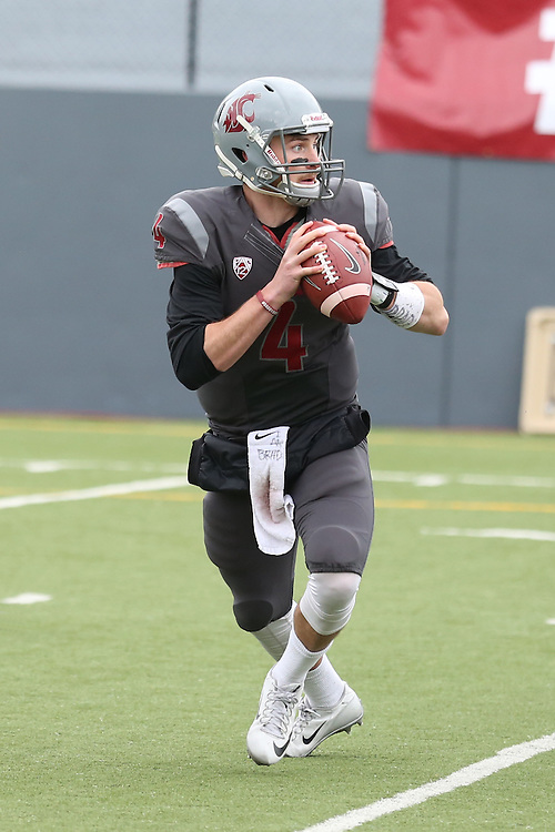 Luke Falk rolls out looking for an open receiver during the annual Washington State Cougar spring game, the Crimson and Gray game, at Joe Albi Stadium in Spokane, Washington, on April 23, 2016.