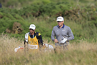 Keegan Bradley (USA) and caddy Chad Reynolds walk to the 14th green during Thursday's Round 1 of the 145th Open Championship held at Royal Troon Golf Club, Troon, Ayreshire, Scotland. 14th July 2016.<br /> Picture: Eoin Clarke | Golffile<br /> <br /> <br /> All photos usage must carry mandatory copyright credit (&copy; Golffile | Eoin Clarke)