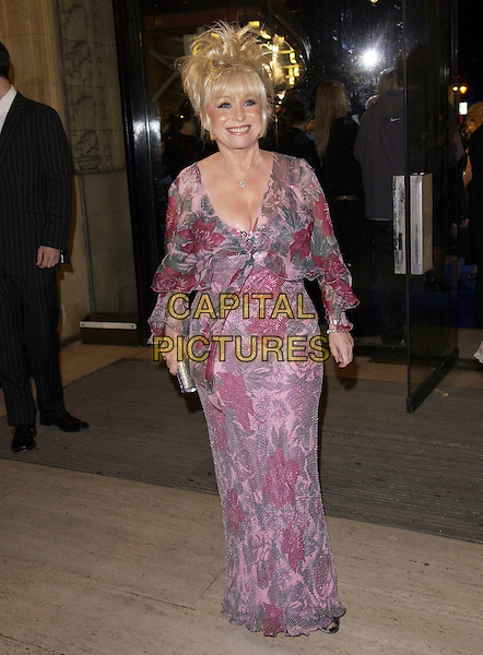 BARBARA WINSOR.National Television Awards 2005 at the Royal Albert Hall.London, United Kingdom.Ref: FIN.full length Eastenders purple mauve pink floor length dress plunging neckline smiling posed.www.capitalpictures.com.sales@capitalpictures.com.© Capital Pictures .