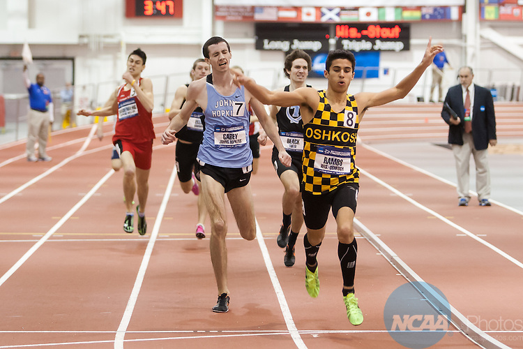 15 March 2014: McKena Ramos from the University of Wisconsin-Oshkosh celebrates as he wins the Men's 800 Meter race during the Div III Indoor Track and Field Championships at Devaney Sports Center in Lincoln, Nebraska. Ramos finished with a time of 1:51.30.