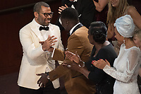 Jordan Peele receives the Oscar&reg; for Best Original Screenplay for work on &ldquo;Get Out&rdquo; during the live ABC Telecast of The 90th Oscars&reg; at the Dolby&reg; Theatre in Hollywood, CA on Sunday, March 4, 2018.<br /> *Editorial Use Only*<br /> CAP/PLF/AMPAS<br /> Supplied by Capital Pictures