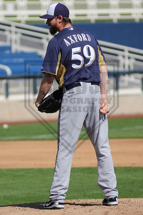 MARYVALE - March 2013: John Axford (59)  of the Milwaukee Brewers during a Spring Training practice on March 17, 2013 at Maryvale Baseball Park in Maryvale, Arizona. (Photo by Brad Krause). .