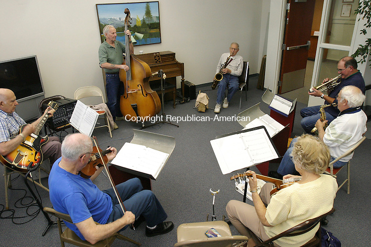 SEYMOUR, CT 9/18/07- 091807BZ01- &quot;Melodies and Memories&quot;, an impromptu band that gathers at the Seymour Senior Center on Tuesday afternoons, plays at the center. <br /> Jamison C. Bazinet Republican-American