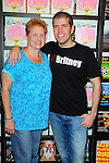 BAL HARBOUR, FL - SEPTEMBER 17: Perez Hilton's mother Teresita Lavandeira and Perez Hilton pose during his book signing of the 'The Boy With The Pink Hair' at Books and Books on September 17, 2011 in Bal Harbour, Florida.  (Photo by Johnny Louis/jlnphotography.com)