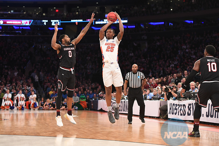 NEW YORK, NY - MARCH 26: Keith Stone #25 of the Florida Gators is guarded by Sindarius Thornwell #0 of the South Carolina Gamecocks during the 2017 NCAA Men's Basketball Tournament held at Madison Square Garden on March 26, 2017 in New York City. (Photo by Justin Tafoya/NCAA Photos via Getty Images)