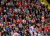 Lincoln City fans watch their team in action<br /> <br /> Photographer Chris Vaughan/CameraSport<br /> <br /> The EFL Sky Bet League Two Play Off First Leg - Lincoln City v Exeter City - Saturday 12th May 2018 - Sincil Bank - Lincoln<br /> <br /> World Copyright &copy; 2018 CameraSport. All rights reserved. 43 Linden Ave. Countesthorpe. Leicester. England. LE8 5PG - Tel: +44 (0) 116 277 4147 - admin@camerasport.com - www.camerasport.com
