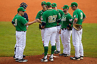 Notre Dame Fighting Irish head coach Mik Aoki #9 hands the ball to pitcher Breck Ashdown #27 as (L-R) catcher Joe Hudson #4, Phil Mosey #33, Tommy Chase #11, Frank DeSico #35, and Trey Mancini #3 look on during a game against the Purdue Boilermakers at the Big Ten/Big East Challenge at Al Lang Stadium on February 19, 2012 in St. Petersburg, Florida.  (Mike Janes/Four Seam Images)