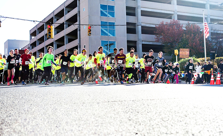 Waterbury, CT- 12 November 2016-111216CM03- Runners take off at the start of a Veteran's Day 5K road race in downtown Waterbury on Saturday.  The event put on by Sacred Heart High School benefited the Sacred Heart High School Scholarship Assistance Program and the Wounded Warriors Project.  Approximately 250 participants entered the race said Mike Madden, one of the event organizers and Assistant Director of Athletics at the school.    Christopher Massa Republican-American
