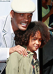 US actor Will Smith poses with son Jaden at the world premiere of 'Kit Kittredge: An American Girl' at the Grove in Los Angeles, California on 14 June 2008. The film is based on the American Girl doll line and centers on Kit Kittredge, a young woman who grows up in the early years of the Great Depression.