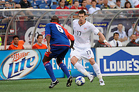 Kenny Cooper (17) of the United States (USA) is marked by Frantz Bertin (6) of Haiti (HAI). The United States and Haiti played to a 2-2 tie during a CONCACAF Gold Cup Group B group stage match at Gillette Stadium in Foxborough, MA, on July 11, 2009. .