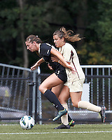 University of Central Florida defender Noel Crane (24) attempts to control the ball as Boston College forward Stephanie McCaffrey (9) defends. After two overtime periods, Boston College tied University of Central Florida, 2-2, at Newton Campus Field, September 9, 2012.