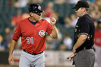 Oklahoma CIty Manager Bobby Jones argues with a PCL umpire on Tuesday August 24th, 2010 at the Dell Diamond in Round Rock, Texas.  (Photo by Andrew Woolley / Four Seam Images)