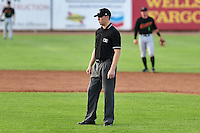 Base umpire Andy Stukel in action during the game against the Great Falls Voyagers and the Ogden Raptors on July 18, 2014 at Lindquist Field in Ogden, Utah. (Stephen Smith/Four Seam Images)