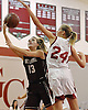 Gabrielle Zaffiro #13 of North Shore, left, tries to get a shot past Grace Brady #24 of Glen Cove during a varsity girls' basketball game at Glen Cove High School on Friday, Dec. 18, 2015. Zaffiro scored a game high 36 points, including 16 in the third quarter, to lead North Shore to a 64-53 win.