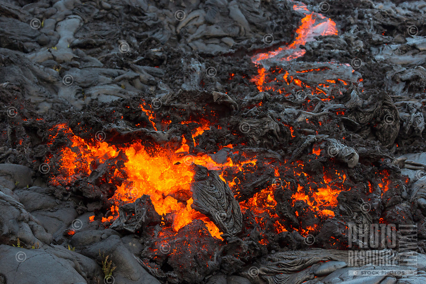 Molten lava breaks through cooled lava in Pulama Pali (of Holei Pali), Hawai'i Volcanoes National Park, Puna district, Hawai'i Island, December 2017.
