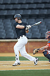 Jake Mueller (6) of the Wake Forest Demon Deacons follows through on his swing against the Virginia Cavaliers at David F. Couch Ballpark on May 18, 2018 in  Winston-Salem, North Carolina.  The Cavaliers defeated the Demon Deacons 15-3.  (Brian Westerholt/Sports On Film)