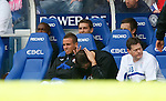 Neil Alexander looking cheesed off in the Rangers dug out
