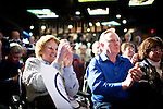 Supporters cheer GOP presidential candidate Newt Gingrich at a campaign event at Great Basin Brewing Company in Reno, Nevada, February 1, 2012.