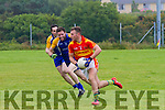 Valentia's Paul O'Connor under pressure from Ballymacelligott's Aidan Breen & T.J.Casey manages to get the better of them to clear the danger area.