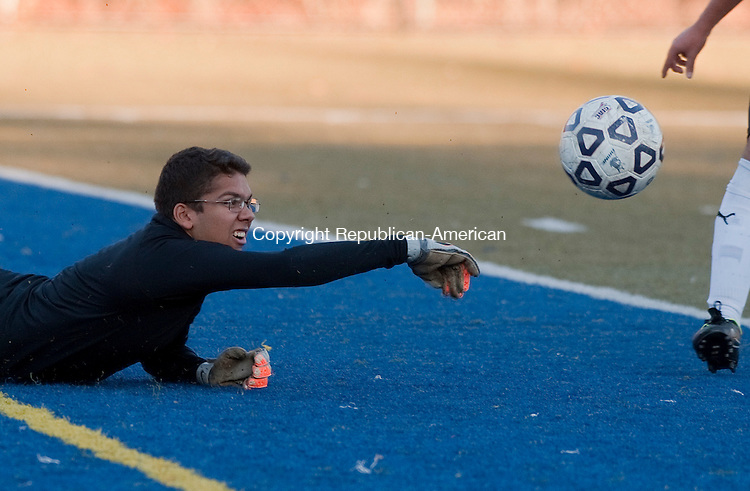 WATERBURY, CT--- -102615JS09---Wilby's goalkeeper Christian Colon knocks the ball away while making a save during their game against Torrington Monday at Municipal Stadium in Waterbury. <br />  Jim Shannon Republican-American