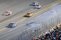 Oct 5, 2008; Talladega, AL, USA; NASCAR Sprint Cup Series driver Martin Truex Jr (1) spins during a multiple car accident during the Amp Energy 500 at the Talladega Superspeedway. Mandatory Credit: Mark J. Rebilas-