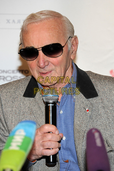 Charles Aznavour.press conference in Moscow, Russia..December 10th, 2011.headshot portrait blue shirt grey gray sunglasses shades microphone.CAP/PER/AL.©AL/PersonaStars/CapitalPictures