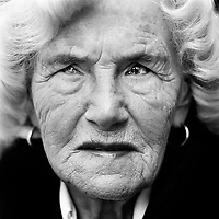 "Sieglinde Bartelsen (b. Germany, 1934), blinded during the Second World War (WWII). In November 1944, the British were bombing the canal locks in the Mittellandkanaal in Minden. We were sitting in an air-raid shelter. The bombs didn't hit the targets but fell nearby our village. The heavy vibrations and air pressure damaged my retina. A day later, I was blind in one eye. In March 1945, my other eye worsened. The eye specialist said that I had a hole in my retina and that I had to lay still and then have an operation. When we arrived in the hospital, it had been evacuated. My mother rode me back home on a bicycle. In the last days of the war I was moved to various safe places. In 1946, I had an operation in Hamburg. I remember that, lying on the operation table, I could see the light and the instruments. I was happy and thought that everything would be alright. After the operation, I saw that the lamp hanging over me had become red. The doctor said that there had been internal bleeding in my eye and that the operation had failed. After that it was all over. I was completely blind. I went to a school for the blind and became a steno typist. I was very fast and won many contests. As a blind woman, I have my complexes.  I give a lot of attention to my appearance but I wear sunglasses. The last time I looked in a mirror, I was fifteen years old and very thin. I thought: ""There is nothing beautiful about me."" Now I regularly get compliments about my looks. Recently a man told me I was an attractive woman. I answered: ""Thank you for the compliment,"" and he said: ""It's not a compliment but an observation.""  . CHECK with MRM/FNA"