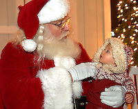 Children share their Christmas wishes with Santa Claus during the annual Christmas tree lighting event at Birkdale Village in Huntersville, NC. Birkdale Village combines the best of shopping, dining, apartments and entertainment venues within a 52-acre mixed-use development.