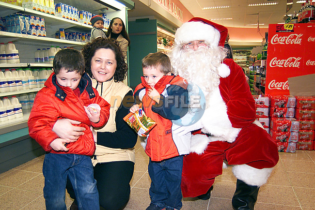 Jamie,Nathan,and Angela Seery with Santa in Super Value in Stockwell Street...Pic Tony Campbell Newsfile