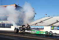 Feb 4, 2016; Chandler, AZ, USA; Smoke comes from the engine of the dragster of NHRA top fuel driver Leah Pritchett during pre season testing at Wild Horse Pass Motorsports Park. Mandatory Credit: Mark J. Rebilas-USA TODAY Sports