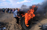 Palestinian protesters gather during clashes with Israeli troops in tents protest where Palestinian demand the right to return to their homeland at the Israel-Gaza border, in al-Bureij in the center of Gaza Strip on July 20, 2018. Photo by Mahmoud Khattab