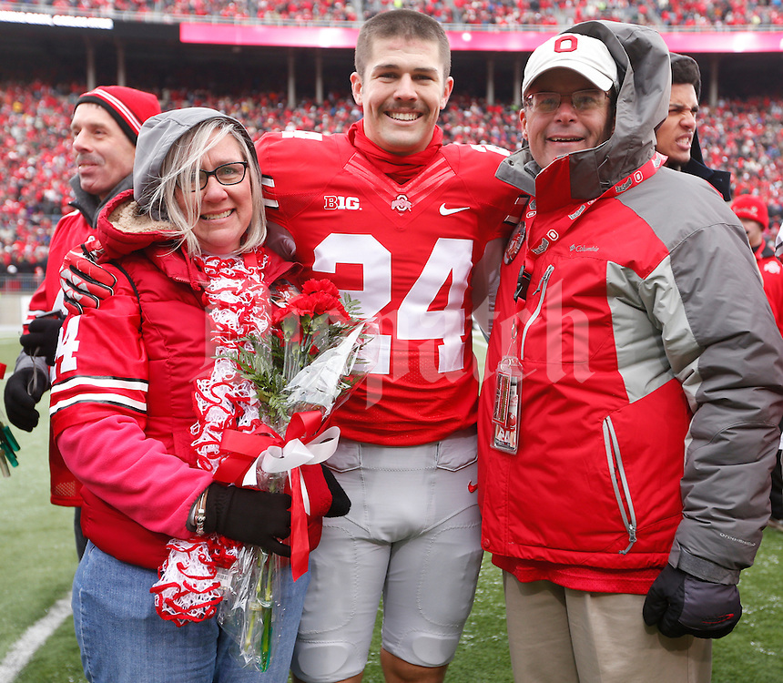 Ohio State Buckeyes kicker Drew Basil (24) was one of nineteen seniors recognized before Saturday's NCAA Division I football game against Indiana at Ohio Stadium in Columbus on November 23, 2013. (Barbara J. Perenic/The Columbus Dispatch)