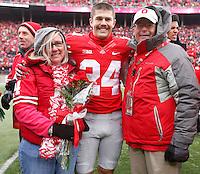 Ohio State Buckeyes kicker Drew Basil (24) was one of nineteen seniors recognized before Saturday's NCAA Division I football game against Indiana at Ohio Stadium in Columbus on November 23, 2013. (Barbara J. Perenic/The Columbus Dispatch)