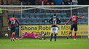 St Johnstone's Brian Graham scores from the penalty spot.