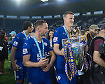 Leicester's Robert Huth celebrates with the trophy during the Barclays Premier League match at the King Power Stadium.  Photo credit should read: David Klein/Sportimage