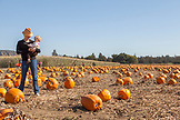 USA, Oregon, Bend, a woman and her daughter at the annual pumpkin patch located in Terrebone near Smith Rock State Park
