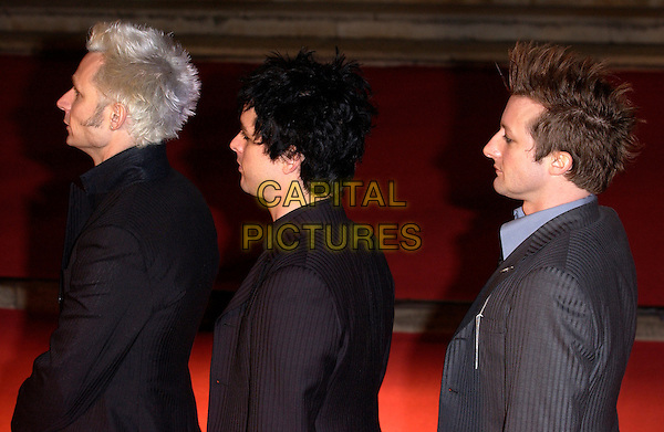 GREEN DAY.MIKE DIRNT, BILLIE JOE ARMSTRONG & TRE COOL.Red Carpet Arrivals at the Brit Awards 2005,.Earls Court 2, London, February 9th 2005..half length funny profiles.Ref: FIN.www.capitalpictures.com.sales@capitalpictures.com.©Steve Finn/Capital Pictures .