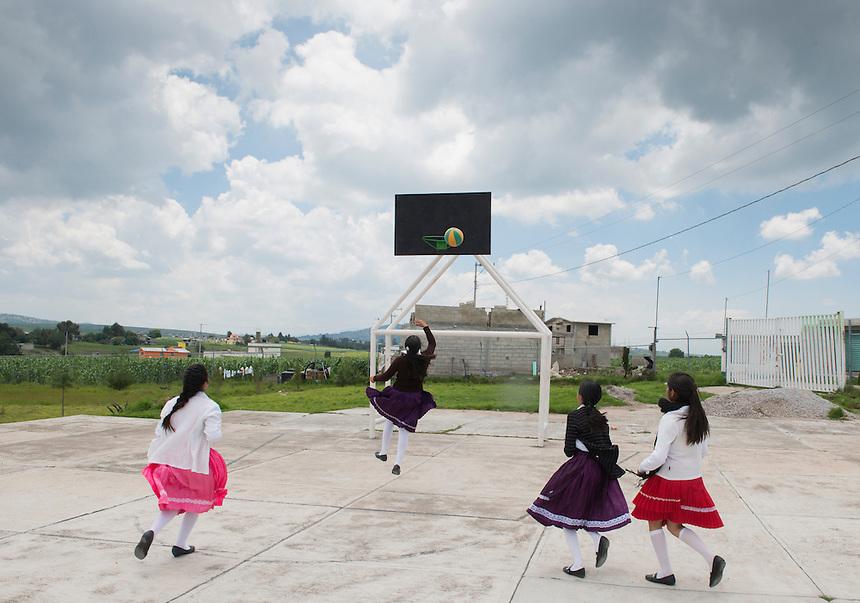 Girls play during break time at the Secondary school Justo Sierra in the  Mazahua indigenous community of San Antonio la Cienega, San Felipe del Progreso, in the Estado de mexico, Mexico
